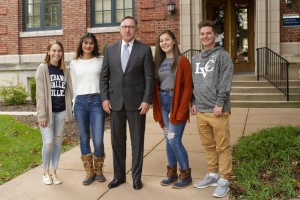 Dr. Lewis E. Thayne poses with students at Lebanon Valley College