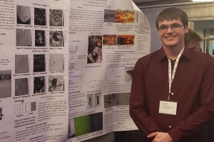 Collin Barker presents physics research at a conference as a Lebanon Valley College undergrad