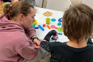 Lebanon Valley College student Sam Dardzinski works with a child at a homeless shelter