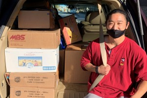 Lebanon Valley College student James Song makes a delivery to the food pantry