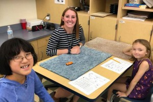 Lebanon Valley College speech-language pathology major Kelsey Bouder works with local students.