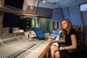 Lebanon Valley College music student Ally Hepp sits at a control board