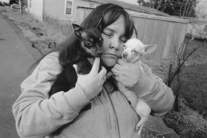 A image of Tiny and her dogs taken by Mary Ellen Mark