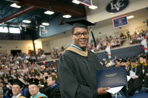 A student receives his diploma at an LVC commencement ceremony
