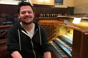 LVC alum Justin Weilnau poses with his organ